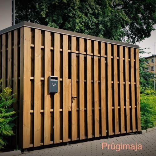 Metallkarkassil puitlaudisega prügimaja